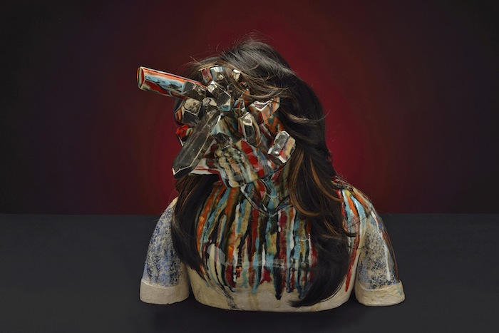 Roxanne Jackson , Title: Steal Your Face, 2013 Media: Ceramic, glaze, ceramic decals, wig, platinum silver luster Dimensions: 18 x 22 x 13 inches