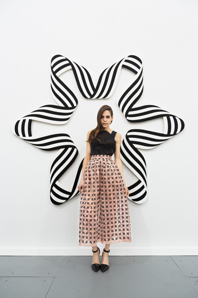 Paridust in front of a wall installation by Philippe Decrauzat, at Frieze New York, Randall's Island, wearing Delpozo. Photograph by Tylor Hou, 2014