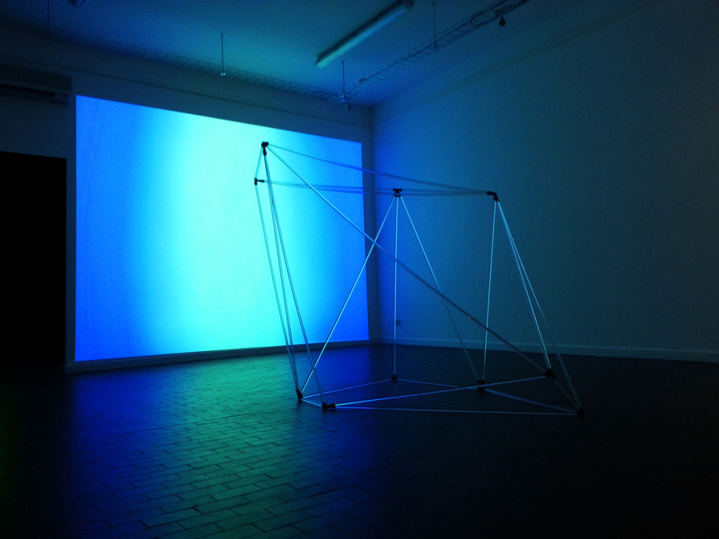 Anne Katrine Senstad, The Venice Biennale installation view. Exhibition title: Metamorphosis of the Virtual. Sculptural piece titled Universals, projection of video piece Color Synesthesia, Silent version. 60 min DV.